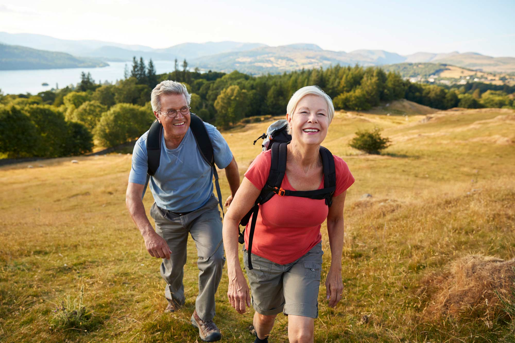older couple laughing on a hike